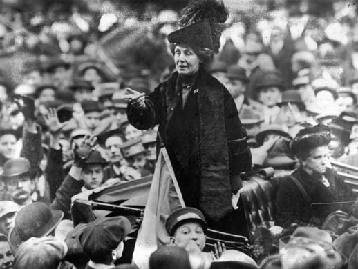 circa 1911: British suffragette Emmeline Pankhurst (1858 - 1928), being jeered by a crowd in New York. (Photo by Topical Press Agency/Getty Images) black & white;format landscape;vehicle;carriage;Roles & Occupations;Rallies & Public Speaking;British;English;North America;TOP 7726 1/1;P/PANKHURST/EMMELINE/1857-1928/BRITISH SUFFRAGETTE